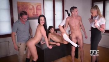 Long haired babe Mikaela gets naked and sucks cock