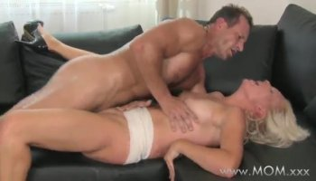 Lustful Pink Pimpa lies on the bed and takes care of her sexual urges